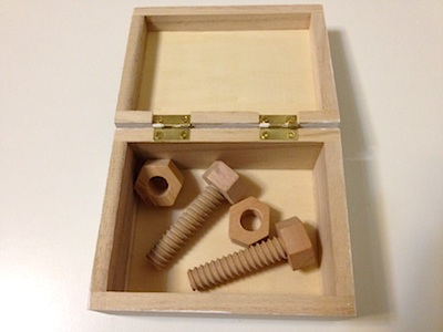 Montessori work for toddler screwing nuts and bolts