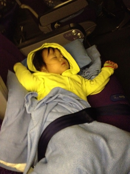 Toddler on night flight
